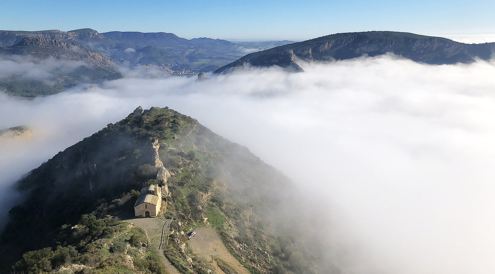 Hermitage of Castell above the fog that characterizes the area during the months of December and January #turismodeboira